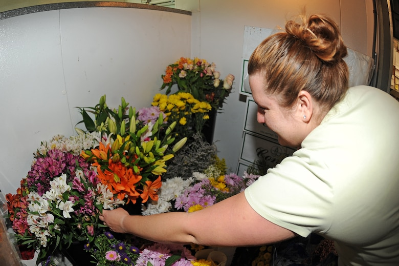 Brandy Daingerfield, Petals and Blooms floral designer, selects flowers for a bouquet in the flower shop at Seymour Johnson Air Force Base, N.C., May 11, 2012. The flower shop carries more than 15 different types of flowers to include roses, daisies and lilies. Dangerfield, spouse of U.S. Air Force Tech. Sgt. Michael Daingerfield, 4th Communications Squadron NCO in-charge of infrastructure, is from Woodbury, Tenn. (U.S. Air Force photo/Airman 1st Class John Nieves Camacho/Released)