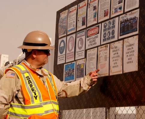 AFGHANISTAN — Jeffrey Ice, a U.S. Army Corps of Engineers Afghanistan Engineer District - South safety specialist, reviews the safety board at a USACE construction site in Helmand province May 8, 2012.