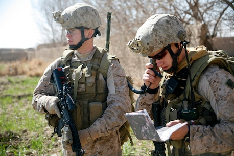 """Sgt. Bradley Smith (far left), from Shawnee, Okla., a scout observer with 2nd Air Naval Gunfire Liaison Company, I Marine Expeditionary Force (Forward), looks on as Staff Sgt. Vincent Bartczak, a Cleveland native and joint tactical air controller with 2nd ANGLICO, discusses a patrol route with British Army Maj. Matt Collins, a Windsor, England, native and kandak commander advisor for the 1st Battalion Irish Guard's Brigade Advisory Group, during Operation Omid Shash, Feb. 17, in Gereshk, Helmand province, Afghanistan. Second ANGLICO Marines and sailors have been supporting several U.S. and coalition units in Helmand province with their unique ability to coordinate tactics on the ground with aviation and other supporting arms assets since arriving in Afghanistan in November. During Omid Shash, 2nd ANGLICO Marines provided coalition and Afghan National Army units maneuvering through the area of operation access to virtually any aviation asset """"on station"""" for intelligence gathering or, if need arose, decisive firepower to defeat Taliban insurgents."""