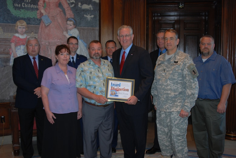 Mark Young, a Missouri State employee at the 139th Airlift Wing, receives the 2012 Missouri State Employee Award of Distinction from Missouri Governor Jay Nixon in Jefferson City, Mo., May 10, 2012. (Photo by Master Sgt. Mike R. Smith/Missouri Air Guard)