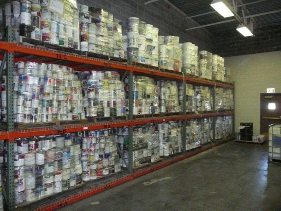 """BEFORE -- Thousand of cans of leftover or unwanted paint are sorted and shelved at Visions Recycling, Inc., located at the former McClellan Air Force Base, prior to blending.  """"We can make any color,"""" says owner Jerry Noel, a former painting contractor.  (Courtesy photo)"""