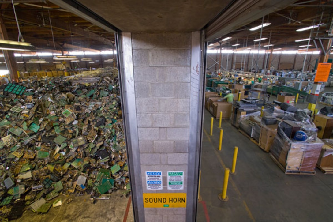 Mountains of e-waste fill a huge storage building at the former Mather Air Force Base, now home to California Electronic Asset Recovery.  CEAR recycled approximately 22 million pounds of e-waste in 2011 and is expanding into a second building at Mather.  (Courtesy photo)