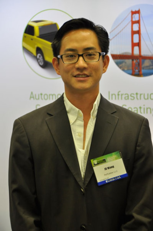 J.D. Wang, CEO of reRubber, is bringing 120 green jobs to his factory in the former Norton Air Force Base commissary.  The company, headquartered in nearby Ontario, Calif., recycles some of the 300 million tires scrapped in the U.S. each year into products like flooring for playgrounds. (Photo by Scott Johnston)