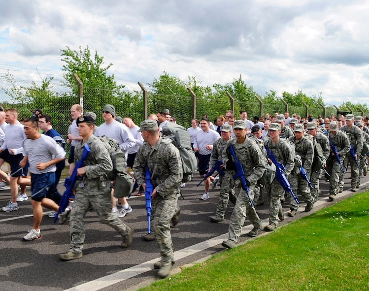 RAF MILDENHALL, England – Airmen from the 100th Security Forces Squadron participate in the Team Mildenhall 5K here May 11, 2012. The run is a monthly event that helps to build morale and fitness through healthy competition. (U.S. Air Force photo/Senior Airman Ethan Morgan)
