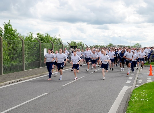 RAF MILDENHALL, England – Airmen begin the Team Mildenhall 5K run here May 11, 2012. The 100th Air Refueling Wing hosts a monthly 5K to help promote fitness and camaraderie. (U.S. Air Force photo/Senior Airman Ethan Morgan)