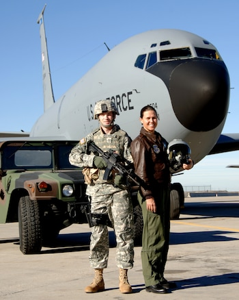 "Lt. Col. Lisa Berente, a KC-135 pilot and Chief of Safety for the 151st Air Refueling Wing, poses in front of a KC-135.  Berente was recently featured in ""Military Fly Moms,"" a coffee table book featuring military pilots who are also mothers.  (U.S. Air Force courtesy photo)"