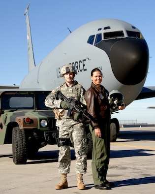 """Lt. Col. Lisa Berente, a KC-135 pilot and Chief of Safety for the 151st Air Refueling Wing, poses in front of a KC-135.  Berente was recently featured in """"Military Fly Moms,"""" a coffee table book featuring military pilots who are also mothers.  (U.S. Air Force courtesy photo)"""