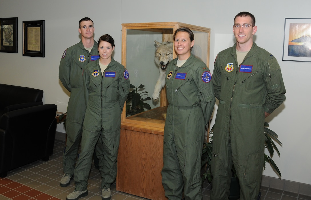 """SIOUX FALLS, S.D. - New F-16 pilot candidates for the 175th Fighter Squadron, South Dakota Air National Guard include, left to right; 2nd Lt. Brant Ravenscroft, 2nd Lt. Valerie Vanderostyne, 2nd Lt. Shanon Davis, and 1st Lt. Blake Schneider.  The new """"Lobos"""" will be attending Undergraduate Pilot Training over the next 13 months and amongst them is the unit's first two female F-16 pilots. (National Guard photo by Master Sgt. Christopher Stewart)(Released)"""
