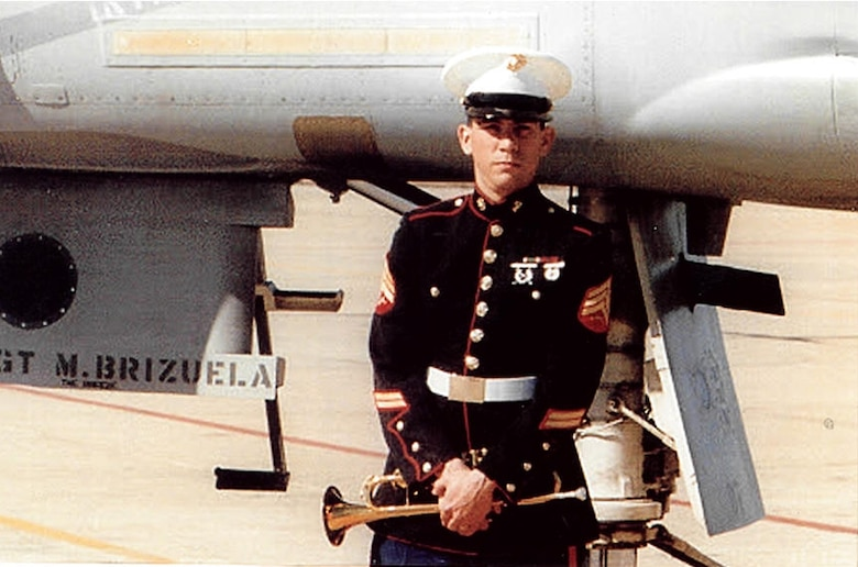 U.S. Marine Corp Sgt. Michael Brizuela takes a photo with his bugle and his F-4 Phantom at Naval Air Station Dallas in 1988. For 30 years he has volunteered with Marine and Air Guard Honor Guards. (Courtesy photo)