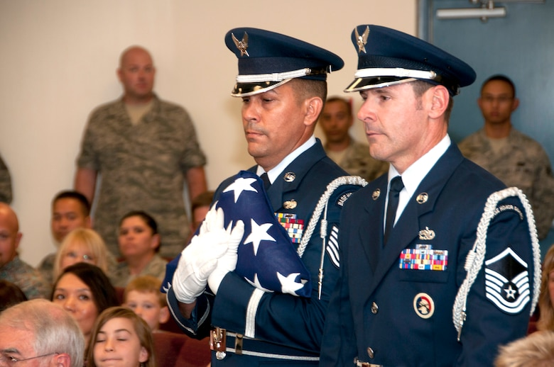 "Tech. Sgt. Michael Brizuela, left, performs a flag folding ceremony at a military retirement at the 162nd Fighter Wing in Tucson, Ariz. Thirty years ago this Memorial Day he first signed up for Honor Guard duty and has steadily volunteered ever since. ""I'm just grateful I can still do this all these years later. I want to be useful to the end and I hope I can even help post the colors at my own retirement one day,"" Brizuela said. (U.S. Air Force photo/Master Sgt. Dave Neve)"