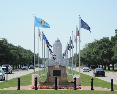 """Visitors and newcomers to Joint Base San Antonio-Randolph are greeted by the flags of all 50 states and the base landmark  """"Taj Mahal"""".  (U.S. Air Force photo by Rich McFadden)"""