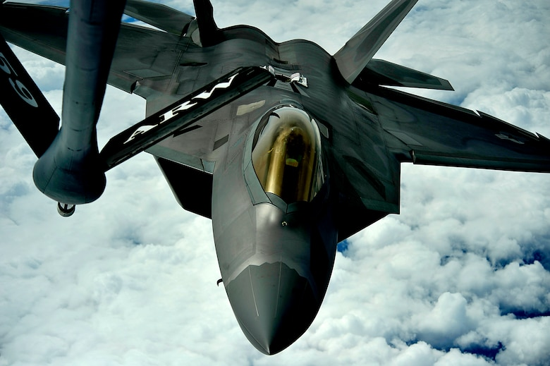 A 1st Fighter Wing's F-22 Raptor from Joint Base Langley-Eustis, Va. pulls into position to accept fuel from a KC-135 Stratotanker with the 756th Air Refueling Squadron, Joint Base Andrews Naval Air Facility, Md. off the east coast on May 10, 2012. The first Raptor assigned to the Wing arrived Jan. 7, 2005. This aircraft was allocated as a trainer, and was docked in a hanger for maintenance personnel to familiarize themselves with its complex systems. The second Raptor, designated for flying operations, arrived Jan. 18, 2005. On Dec. 15, 2005, Air Combat Command commander, along with the 1 FW commander, announced the 27th Fighter Squadron as fully operational capable to fly, fight and win with the F-22. (U.S. Air Force Photo by: Master Sgt. Jeremy Lock) (Released)
