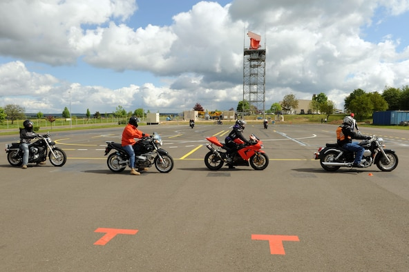 SPANGDAHLEM AIR BASE, Germany – Motorcycle riders execute maneuvers during a motorcycle safety class at the Saber driving course here May 15. The course participants practiced maneuvers to include path of travel, quick stops and obstacle avoidance. The class is geared to improve riders' skill by performing different maneuvers on the course as well as discussing and reviewing a variety of safety information. The 52nd Fighter Wing Safety office conducts the motorcycle safety course three times monthly. U.S Air Forces in Europe regulations mandate that every motorcyclist on base must take or retake this class once every three years to keep their skillset current. (U.S. Air Force photo by Senior Airman Christopher Toon/Released)