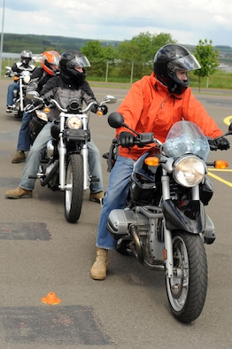 SPANGDAHLEM AIR BASE, Germany – Motorcycle riders wait for their turn to execute maneuvers during a motorcycle safety class at the Saber driving course here May 15. The course participants practiced maneuvers to include path of travel, quick stops and obstacle avoidance. The class is geared to improve riders' skill by performing different maneuvers on the course as well as discussing and reviewing a variety of safety information. The 52nd Fighter Wing Safety office conducts the motorcycle safety course three times monthly. U.S Air Forces in Europe regulations mandate that every motorcyclist on base must take or retake this class once every three years to keep their skillset current. (U.S. Air Force photo by Senior Airman Christopher Toon/Released)