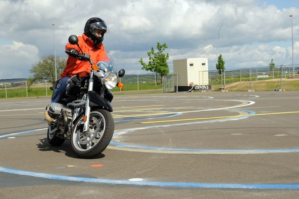 SPANGDAHLEM AIR BASE, Germany – Maj. Erik Olsen, 52nd Operations Support Squadron, maneuvers his motorcycle around a turn during a motorcycle safety class at the Saber driving course here May 15. The course participants practiced maneuvers to include path of travel, quick stops and obstacle avoidance. The class is geared to improve riders' skill by performing different maneuvers on the course as well as discussing and reviewing a variety of safety information. The 52nd Fighter Wing Safety office conducts the motorcycle safety course three times monthly. U.S Air Forces in Europe regulations mandate that every motorcyclist on base must take or retake this class once every three years to keep their skillset current. (U.S. Air Force photo by Senior Airman Christopher Toon/Released)