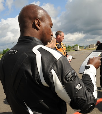 SPANGDAHLEM AIR BASE, Germany – Tech. Sgt. Anthony Toliver, 52nd Aircraft Maintenance Squadron, reviews safety material during the motorcycle safety class at the Saber driving course here May 15. The class is geared to improve riders' skill by performing different maneuvers on the course as well as discussing and reviewing a variety of safety information. The 52nd Fighter Wing Safety office conducts the motorcycle safety course three times monthly. U.S Air Forces in Europe regulations mandate that every motorcyclist on base must take or retake this class once every three years to keep their skillset current. (U.S. Air Force photo by Senior Airman Christopher Toon/Released)