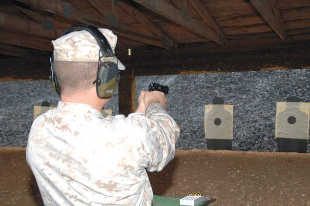 Staff Sgt. Matthew Maloy, Logistics Services Management Center tank equipment specialist, Marine Corps Logistics Command, fires a Beretta M9 pistol at Marine Corps Logistics Base Albany's Recreational Pistol Range, April 25, for his annual weapons qualification. He was among 25 Marines and four civilian police officers who fired at the newly-upgraded range.