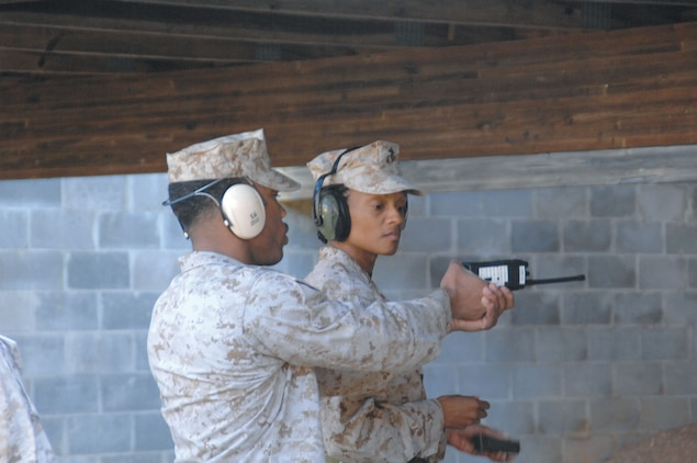 Maj. Latresa Steward, right, receives firing tips from Sgt. Nicholas McMorris, range noncommissioned officer-in-charge, Marine Corps Logistics Base Albany, to help hit her target.
