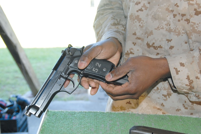 Gunnery Sgt. Kejuan Hull loads his Beretta M9 at MCLB Albany's Recreational Pistol Range, recently.
