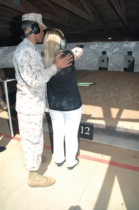 Sgt. Nicholas McMorris, range noncommissioned officer-in-charge, Marine Corps Logistics Base Albany, teaches a supplier how to shoot at the Recreational Pistol Range during the second annual Key Wholesale Supplier Day here, April 25-27. The three-day event allowed participants to become familiar with the Marine Corps and MCLC's mission in support of the warfighter.