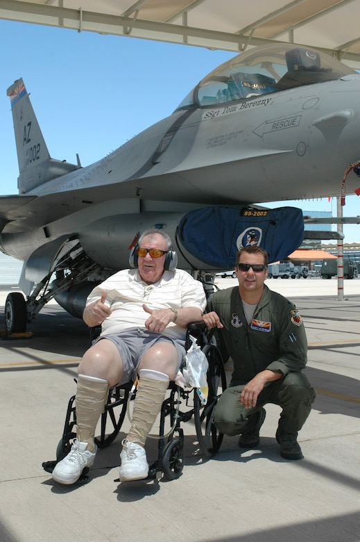 Lt. Col. Scott Reinhold and Bill Englund, a hospice patient from Phoenix, watch F-16 Fighting Falcons taxi by on the 162nd Fighter Wing flightline at Tucson International Airport, May 17. Reinhold worked with the Phoenix-based Bucket List Foundation to help give Englund a 'pilot for a day' experience. (U.S. Air Force photo/Maj. Gabe Johnson)