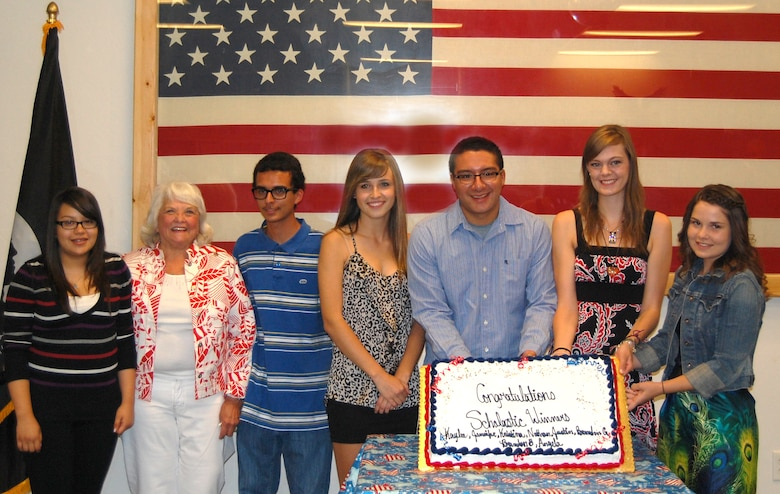 (From the left) Angela Bautista, American Veterans Scholarship Chair Charline Hill, Brandon Barnett, Kaylee McClelland, Nathan Federico, Kristina Farrell, and Jennifer Trueblood celebrate at Tucson's AMVETS Post 770 Ladies Auxiliary 2012 Scholarship Awards Dinner, May 12. The post awarded seven $500 scholarships and one $100 recognition award to children of 162nd Fighter Wing members. (Scholarship recipients Brandon and Justin Garms are not pictured.) (U.S. Air Force photo/Airman 1st Class Roberto Gonzalez)