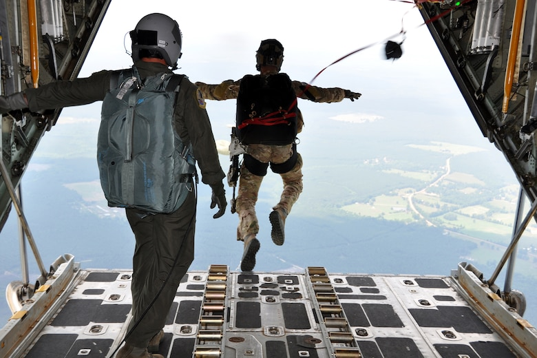 A Pararescueman from the 920th Rescue Wing, jumps from an HC-130 King to perform combat search and rescue(CSAR)  missions on Fort Polk, La., in support of the Patriot Saint exercise, May 16, 2012. Patriot Saint presents real-time, realistic CSAR scenarios and was conducted and led by Air Force Reserve Command's 10th Air Force. (U.S. Air Force photo by Master Sgt. Joshua Woods/Released)