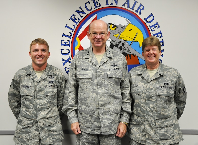 Tech. Sgt. Cassandra Freer (right) and Staff Sgt. Nicholas Ramsey (left) of Det. 1, 125th Fighter Wing, were both singled out by NORAD and Adjutant General of Florida Maj. Gen. Emmett Titshaw Jr. (center) on May 16, 2012, for their contributions to helping the unit score well during the recent inspection. Photo by Master Sgt. Thomas Kielbasa