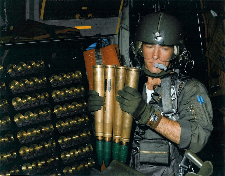 AC-130 gunner Sgt. Donald Dawson pulls out a four-round 40mm clip from the onboard storage rack. (U.S. Air Force photo)