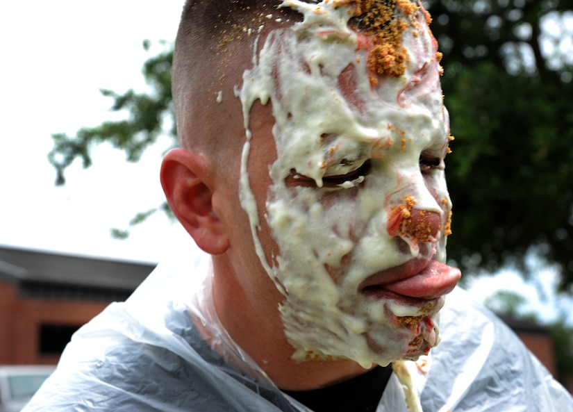 Senior Master Sgt. Jason Heilman, 628th Security Forces Squadron, gets a pie in the face May 16 at Joint Base Charleston - Air Base, S.C. For the Pie in the Face Contest, personnel from the 628th SFS placed money down toward who they wanted to be picked. The highest and the lowest number of votes were the chosen ones. The money raised for this event will go toward the Special Olympics in South Carolina. (U.S. Air Force photo/Airman 1st Class Ashlee Galloway)
