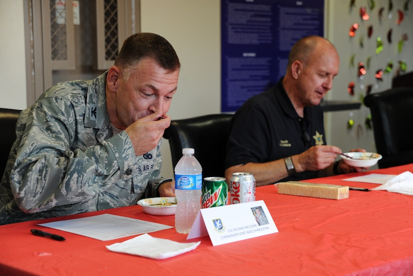Col. Richard McComb, Joint Base Charleston Commander, and Al Cannon, Sheriff of Charleston County, were judges at the 628th Security Forces Squadron Chili Cook Off, May 15 at Joint Base Charleston - Air Base. This event was part of National Police Week, which occurs annually during the week of May 15, recognizing the service and sacrifice of U.S. law enforcement personnel. (U.S. Air Force photo/Airman 1st Class Ashlee Galloway)