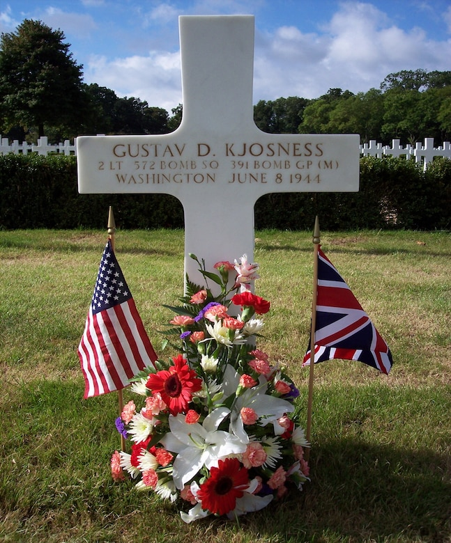 A photo of the Madingley American Cemetery (Cambridge, England) gravesite of 2nd Lt. Gustav D. Kjosness, 572nd Bomb Squadron, U.S. Army Air Forces, who was killed while performing a bombing mission against enemy ground targets June 6, 1944.  Kjosness, a B-26 Marauder bombardier, died while paving the success for the Normandy, France, landings, and was posthumously awarded the Distinguished Service Cross, the second highest award in the U.S. Army, equal to the Air Force Cross. (Courtesy photo)