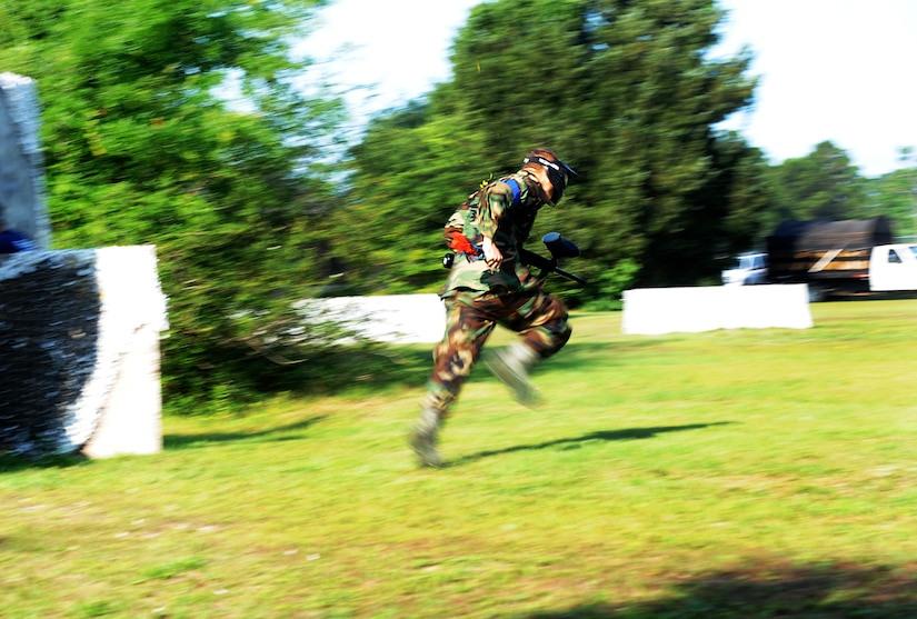 "Airman 1st Class Andrew Bradley, 628th Civil Engineer Squadron firefighter, takes off during a paintball match against defenders from the 628th Security Forces Squadron during the ""Guns and Hoses"" fitness challenge, May 15 at Joint Base Charleston - Air Base, S.C. The 628th SFS hosted the firefighters in a day full of competition known as the ""Guns and Hoses"" fitness challenge. The competitions included a paintball match, defender ball and a softball game. The event kicked off National Police Week, which occurs annually during the week of May 15. National Police Week recognizes the service and sacrifice of U.S. law enforcement personnel. (U.S. Air Force photo/Airman 1st Class Ashlee Galloway)"