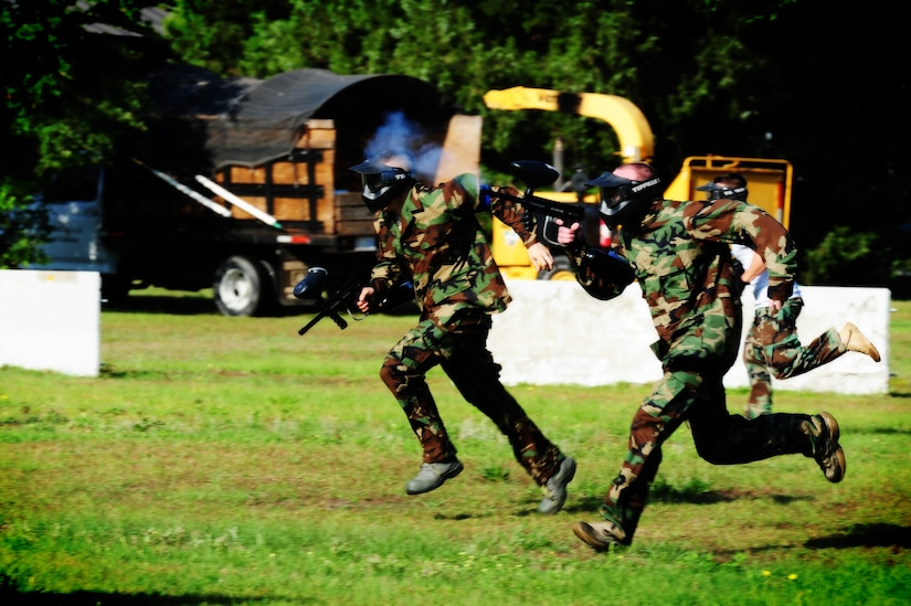 "Firefighters from the 628th Civil Engineer Squadron take off during a paintball match against defenders from the 628th Security Forces Squadron during the ""Guns and Hoses"" fitness challenge, May 15 at Joint Base Charleston - Air Base, S.C.  The 628th SFS hosted the firefighters in a day full of competition known as the ""Guns and Hoses"" fitness challenge.  The competition included a paintball match, defender ball and a softball game.  The event kicked off National Police Week, which occurs annually during the week of May 15.  It recognizes the service and sacrifice of U.S. law enforcement personnel.  (U.S. Air Force photo/ Staff Sgt. Nicole Mickle)"