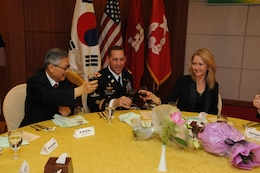 SEOUL, Korea — Suh Jin-Sup (left), Chairman of the ROK-U.S. Alliance Friendship Association, Col. Donald E. Degidio, Jr., Commander of the U.S. Army Corps of Engineers Far East District, and Degidio's wife, Donna, toast during Degidio's Korean naming ceremony May 10 at the Korea Ministry of National Defense.