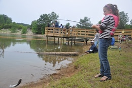 CALHOUN FALLS, S.C. — Kansas Belk of Greenwood, S.C., reels in a catfish at the 24th Annual Kid's Fishing Derby at Richard B. Russell Lake, May 12, 2012.