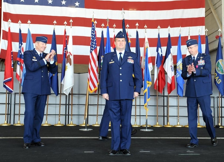 Col. Phil Stewart (center), the newest 9th Reconnaissance Wing commander is congratulated by Lt. Gen. Robin Rand (left), 12th Air Force commander and out-going 9 RW commander, Brig. Gen. Paul McGillicuddy (right) during a change of command ceremony at Beale Air Force Base Calif., May 10, 2012. Rand was the presiding official for the event.  (U.S. Air Force photo by John Schwab/Released)