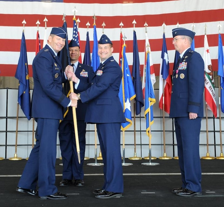 Lt. Gen. Robin Rand, 12th Air Force commander, presents the newest 9th Reconnaissance Wing commander Col. Phil Stewart with the wing's guidon during a change of command ceremony at Beale Air Force Base Calif., May 10, 2012. Stewart severed as the wing's vice commander prior to taking command from Brig. Gen. Paul McGillicuddy (right). (U.S. Air Force photo by John Schwab/Released)