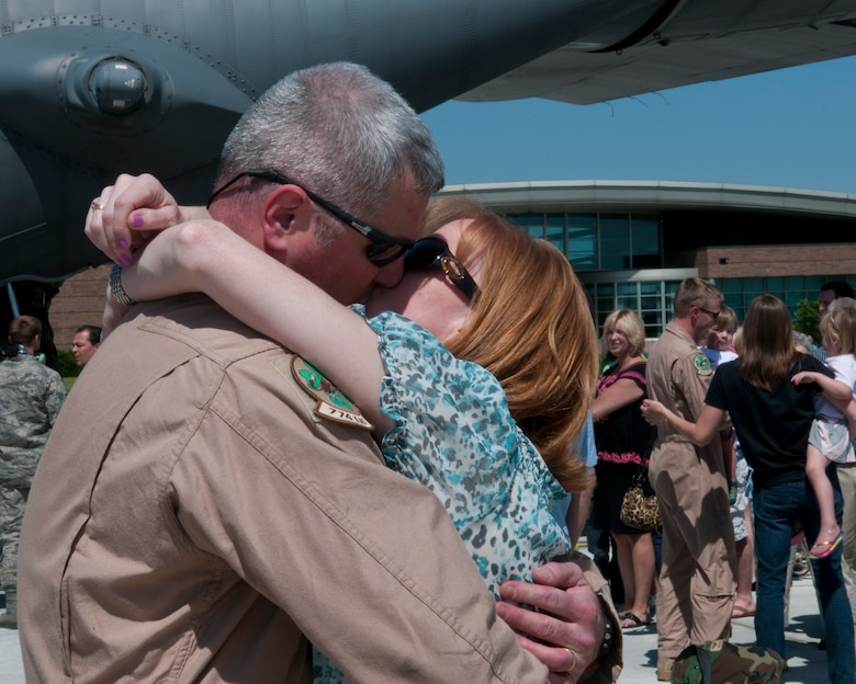 Family and friends greet 133rd Airlift Wing Airmen at the Minneapolis- St. Paul International Airport on May 16, 2012 as they return from a deployment to Southwest Asia. USAF official photo by Senior Master Sgt. Mark Moss