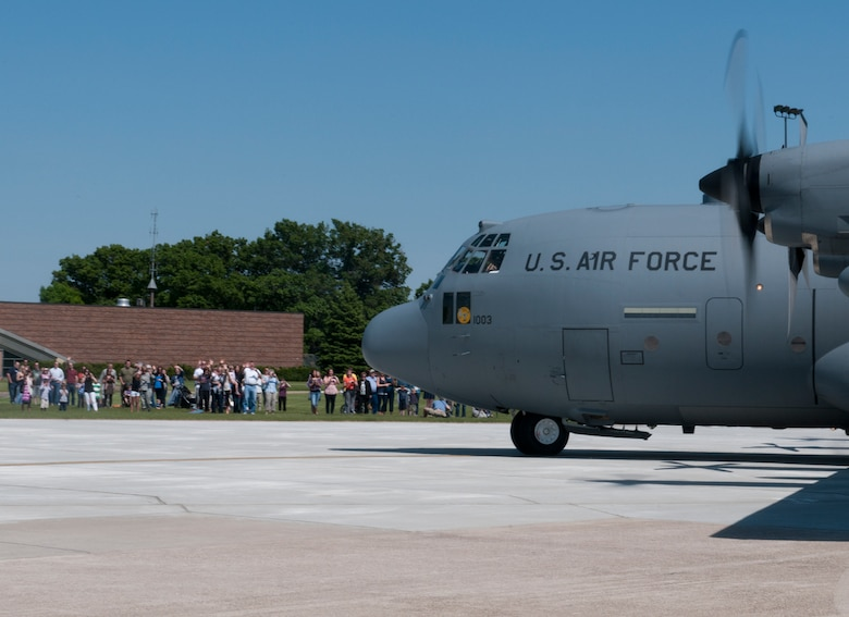 A Minnesota Air National Guard C-130 taxis past waiting family and friends at the Minneapolis- St. Paul International Airport on May 16, 2012, returning from a deployment to Southwest Asia. USAF official photo by Senior Master Sgt. Mark Moss