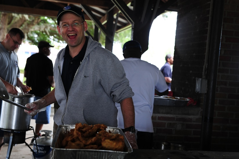 Retired Chief Master Sgt. Andy Comen mans the fryer during the Chiefs Annual Fish Fry, May 18 at Joint Base Charleston - Air Base, S.C.  The fish fry began as a barbeque in 1987 and was a way to unite the Reserve and active-duty members on the air base.  (U.S. Air Force photo/ Staff Sgt. Nicole Mickle)