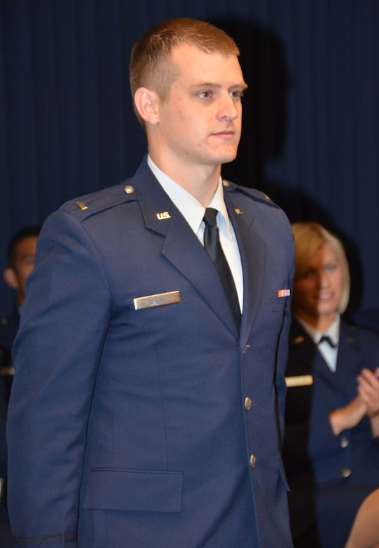 Newly commissioned 2nd Lt. Joshua Reding is formally presented to attendees of the May 11, 2012 University of New Mexico Air Force ROTC commissioning ceremony held at the Air Force Operational Test and Evaluation Center at Kirtland AFB, N.M.