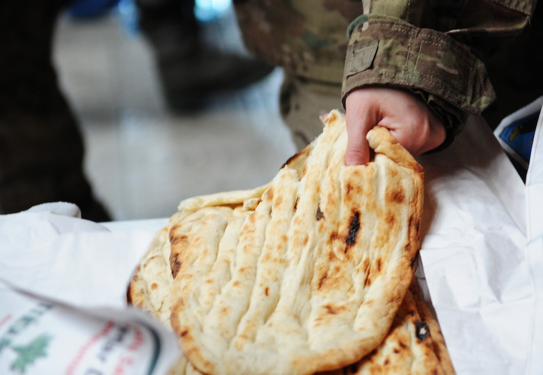 A Soldier grabs a piece of Turkish bread while going through the line at the Incirlik passenger terminal May 12, 2012, at Incirlik Air Base, Turkey. Food and drinks were provided to redeploying service members by Incirlik Airman Leadership School Class 12-D as part of Operation First Stop, a community service project designed to welcome service members traveling through Incirlik after deployments. (U.S. Air Force photo by Senior Airman Marissa Tucker/Released)