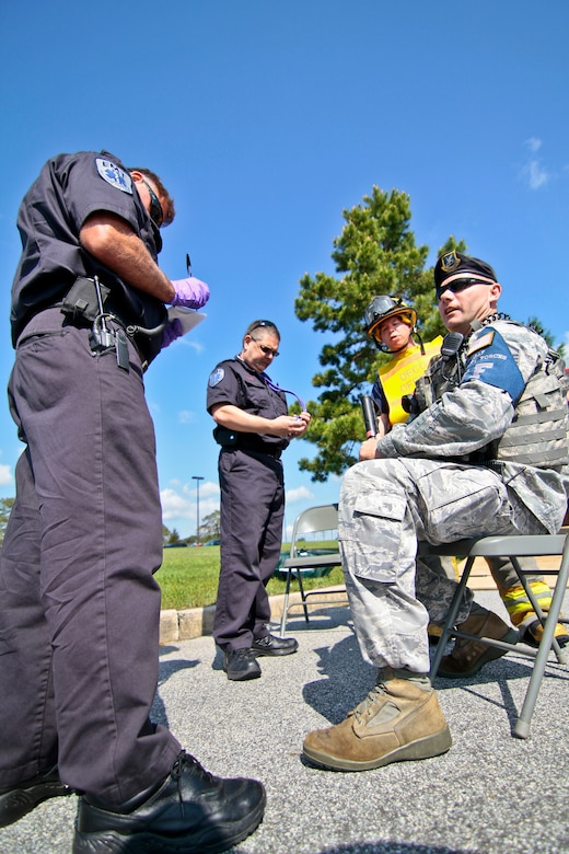 New Jersey Air National Guardsman Master Sgt. Donald Meddings is checked out by Emergency Medical Technicians from the South Jersey Transportation Authority on May 10 during an exercise. The 177th Fighter Wing, located in Egg Harbor Township, NJ, participated with local fire departments and rescue crews for this training scenario.  Meddings is a Security Forces flight chief assigned to the 177th Security Forces Squadron.  U.S. Air Force photo/Tech. Sgt. Matt Hecht