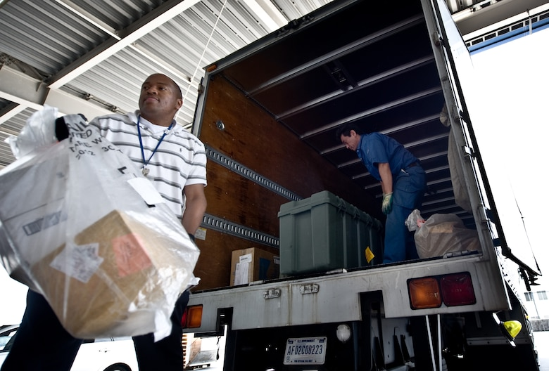 NARITA INTERNATIONAL AIRPORT, Japan -- Master Sgt. Everton Hixson, Detachment 2, Pacific Air Forces Postal Squadron mail control activity chief, unloads mail delivered from Yokota Air Base, Japan, at Narita International Airport, Tokyo, Japan, May, 17, 2012. Postal workers from Det. 2 make two trips a day to pick up mail from Narita. (U.S. Air Force photo by Airman 1st Class Krystal M. Garrett)