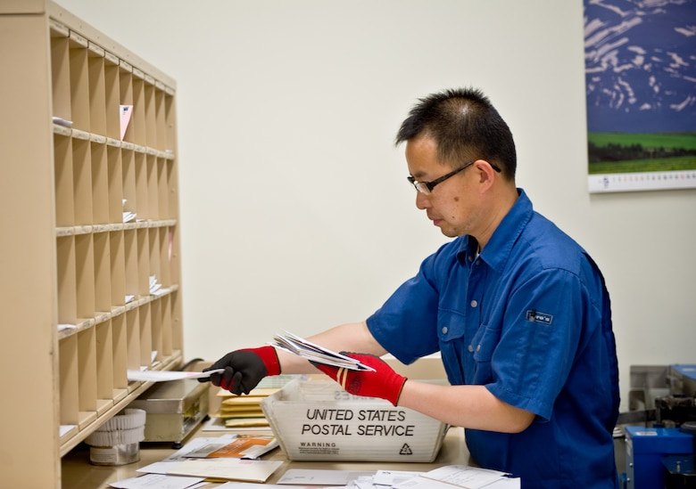YOKOTA AIR BASE, Japan -- Ryoichi Kondo, a postal worker assigned to Detachment 2, of the Pacific Air Forces Postal Squadron, sorts mail for distribution at Yokota Air Base, Japan, May 10, 2012. Det. 2 inspects and sorts mail before sending it to the base post office for distribution to base residents and personnel. (U.S. Air Force photo by Airman 1st Class Krystal M. Garrett)