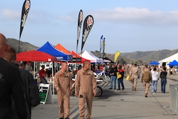 Marines of 1st Marine Division, Marine Air Group and Marine Corps Air Station Camp Pendleton visit booths and participate in the activities at Semp Ride's Fun Day on the Runway at MCASCP, May 18.