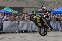 Marines from 1st Marine Division, Marine Air Group 39 and Marine Corps Air Station watch as one of the freestyle demo riders pumps up the crowd at Semper Ride's Fun Day at the Runway on Marine Corps Air Station Camp Pendleton, May 18.
