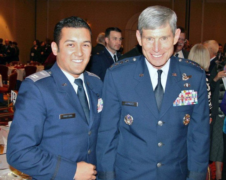 Civil Air Patrol Captain Jonathan Khattar poses with Maj. Gen. Schwartz at the Spaatz Association Annual Banquet held in Washinton D.C. Khattar is also a Senior Airman with the 146th Airlift Wing, working in Command Post. Photograph submitted by Senior Airman Jonathan Khattar.