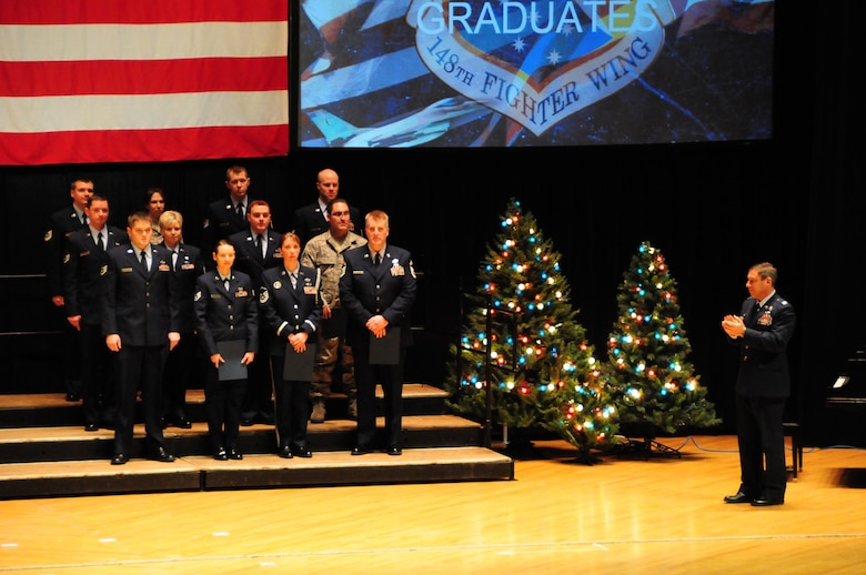 148th Fighter Wing Community College of the Air Force graduates stand during the 2011 award and retirement ceremony at the Duluth Entertainment Convention Center Dec. 4, 2011.  From 2010 to 2011, CCAF graduates have increased 59%. That number is expected to increase for the 148th again in the 2012 graduating classes.  (National Guard photo by Senior Airman Sarah Hayes.)